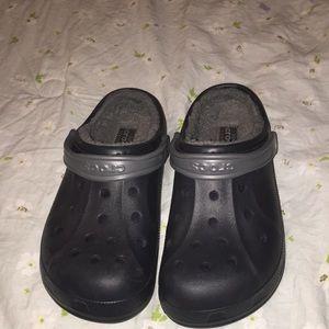 Black fur crocs.
